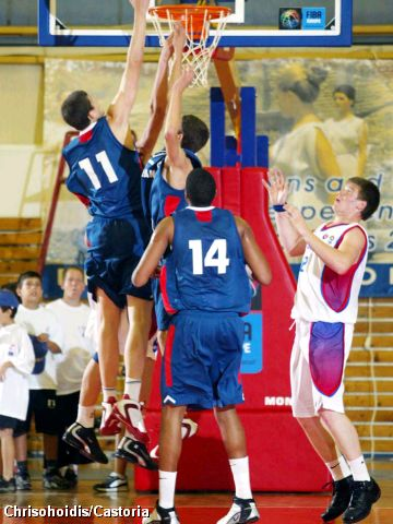 Adrien Moerman skies for a rebound against Russia